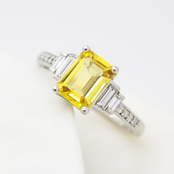 emerald cut yellow sapphire with side diamond baguettes and beat set diamond band