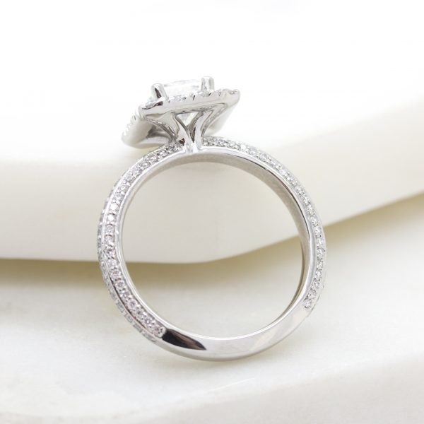 three sided diamond pave band with radiant diamond center and diamond halo