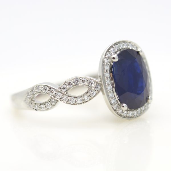 twisted pave band sapphire halo engagement ring