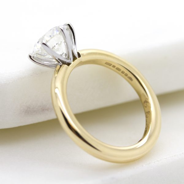 yellow gold and platinum solitaire engagement ring