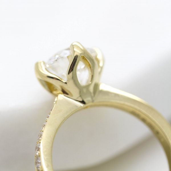 yellow gold engagement ring with floral inspired basket