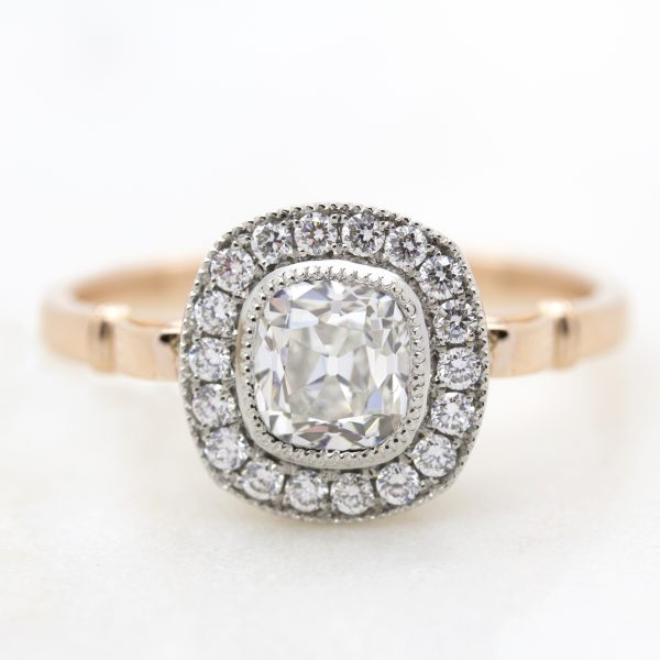 old mine cut diamond with diamond halo in rose gold and platinum