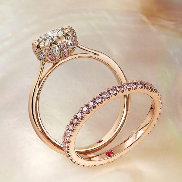 18K rose gold solitaire with white-_-pink-diamonds-set-in-the-gallery with matching wedding band