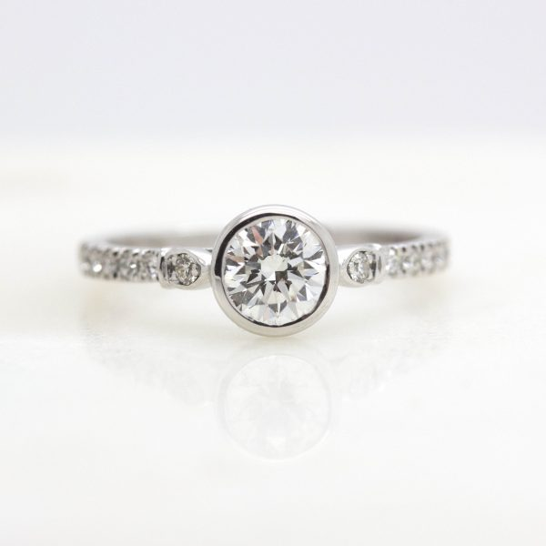 bezel set round diamond with pave diamond engagement ring