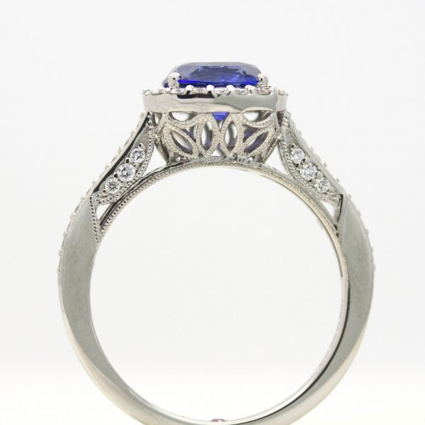 blue sapphire engagement ring with filigree and milgrain