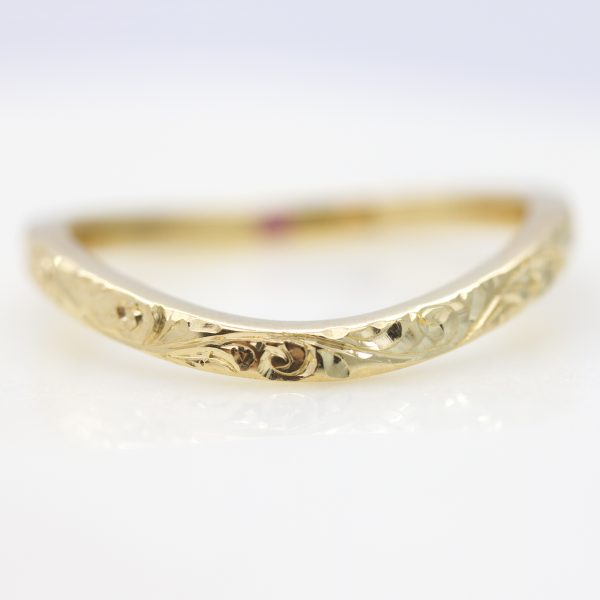 curved hand engraved yellow gold wedding ring