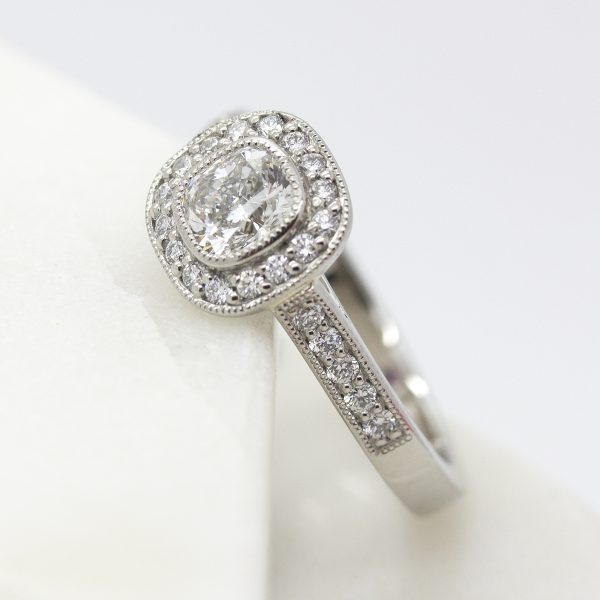 cushion cut diamond halo engagement ring with milgrain