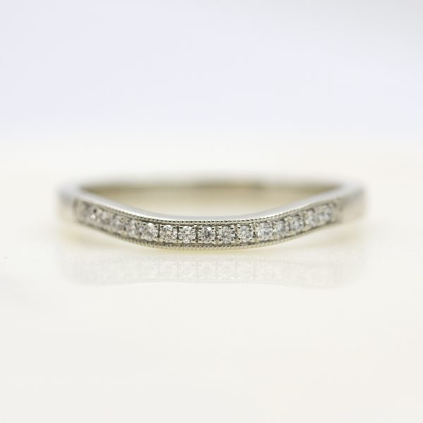 diamond bead set wedding ring shaped to sit flush next to bespoke engagement ring