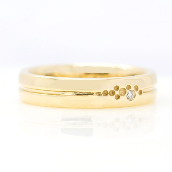 mens yellow gold wedding ring with engraving and small round diamond