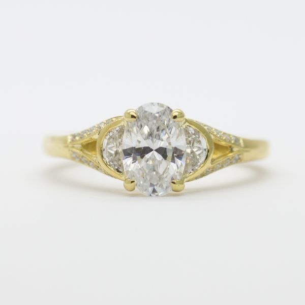 oval diamond with half moon diamond side stones