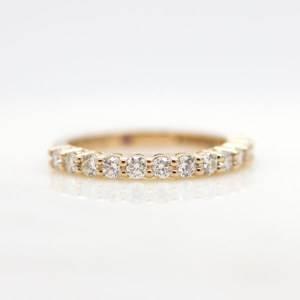 rose gold wedding ring with shared prong set round diamonds