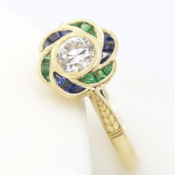 emerald and blue sapphire custom cut floral hand engraved organic engagement ring