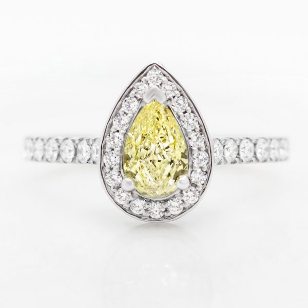 fancy yellow pear shape diamond with diamond halo engagement ring