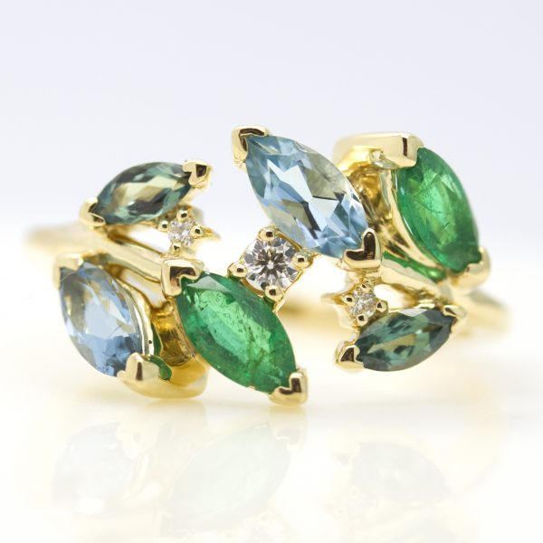 organic inspired emerald and sapphire cluster ring