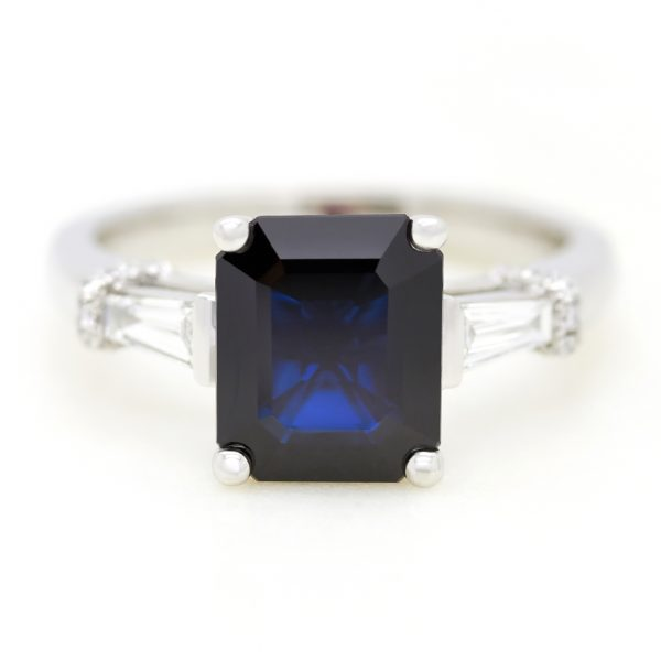 emerald cut blue sapphire trilogy engagemnet ring with diamond tapered baguettes2