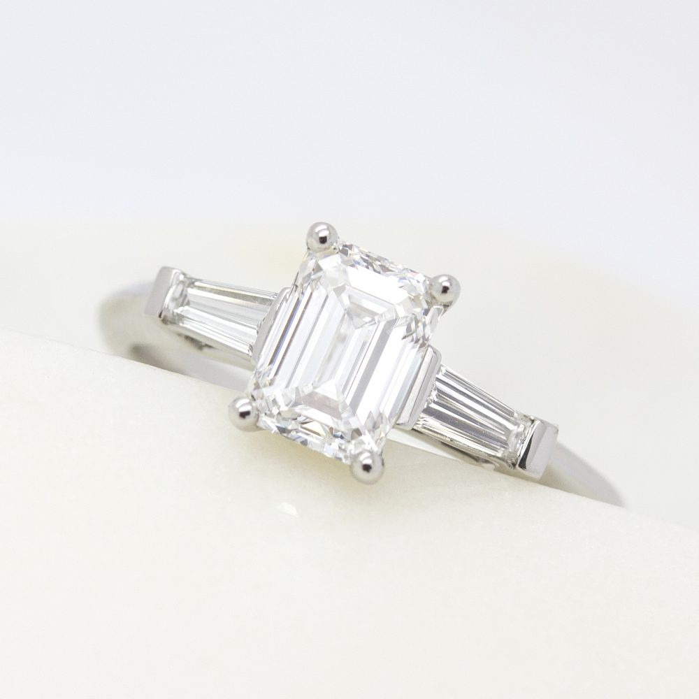 emerald cut diamond ring with tapered diamond baguettes