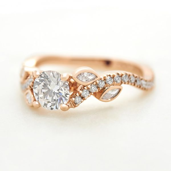round diamond rose gold engagement ring with marquise diamond flower leaf design