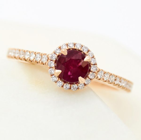 round ruby diamond halo in rose gold engagement ring