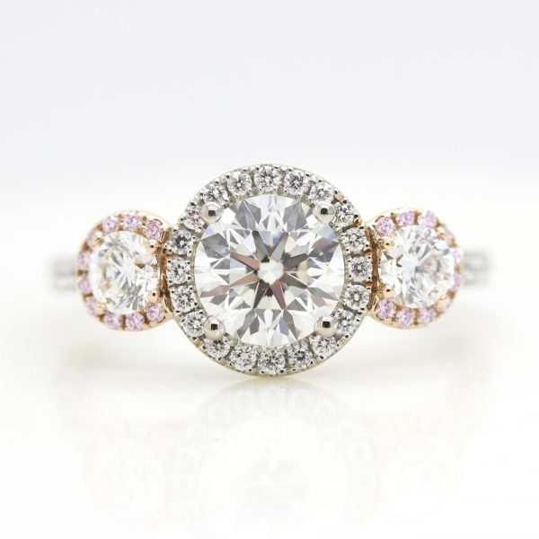 mixed metal round diamond halo trilogy engagement ring