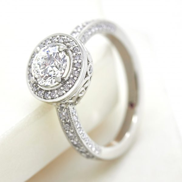 round diamond halo engagement ring with filigree undergallery collet