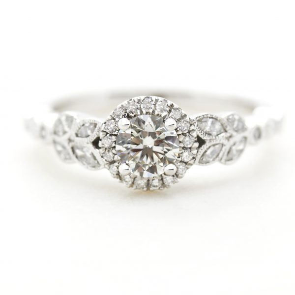 round diamond halo engagement ring with marquise diamond leaf vine milgrain design