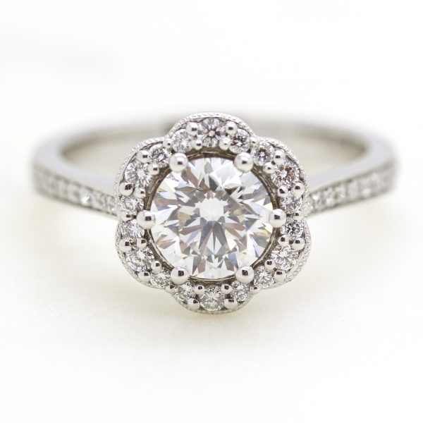 round diamond with flower inspired halo engagement ring