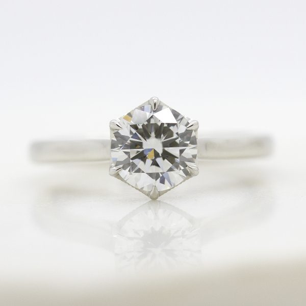 bespoke solitaire detailed collet engagement ring