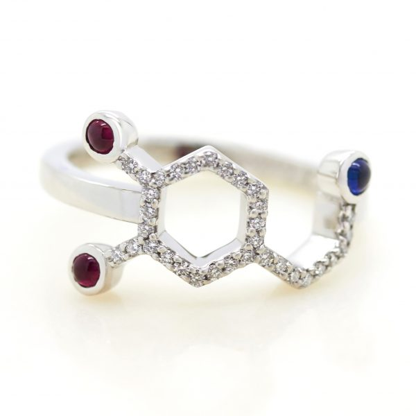 chemical science dopamine inspired engagement ring with blue sapphire and rubies