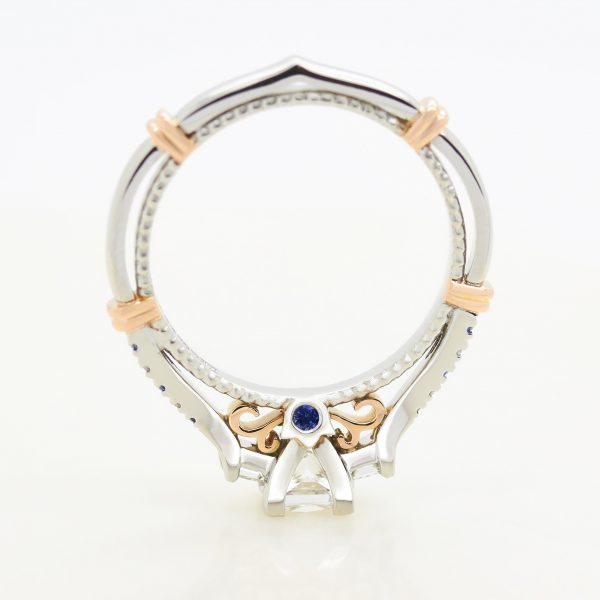 mixed metal engagement ring platinum and rose gold milgrain and bars with filigree and blue sapphire surprise setting taylor andhart