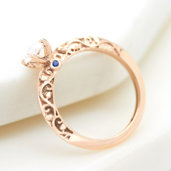 rose gold engagement ring with filigree cut out engraving detail