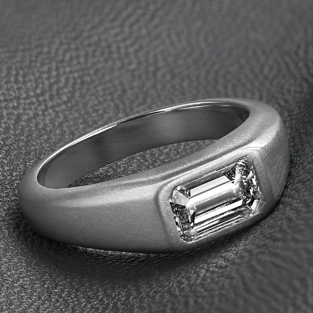emerald cut diamond set into matte brushed platinum mens wedding ring band