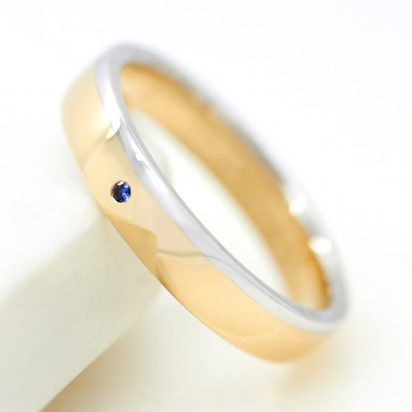 mixed metal mens wedding ring with a round blue sapphire