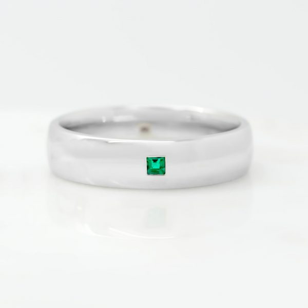 platinum mens wedding ring set with a princess cut emerald