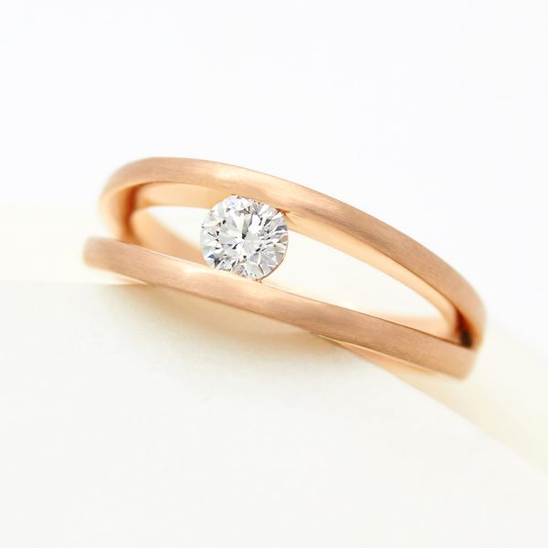 tension set split shank round diamond engagement ring in rose gold