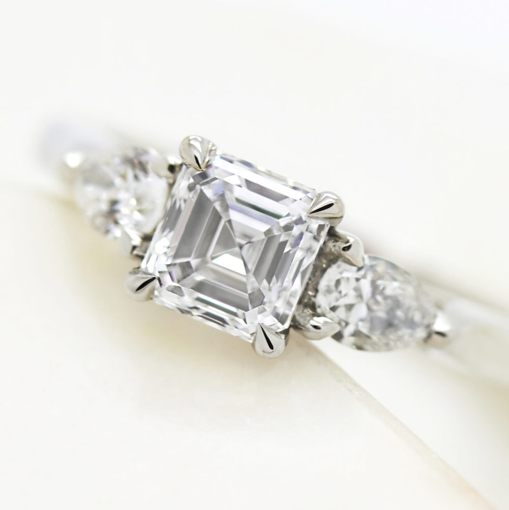 asscher cut diamond trilogy engagement ring