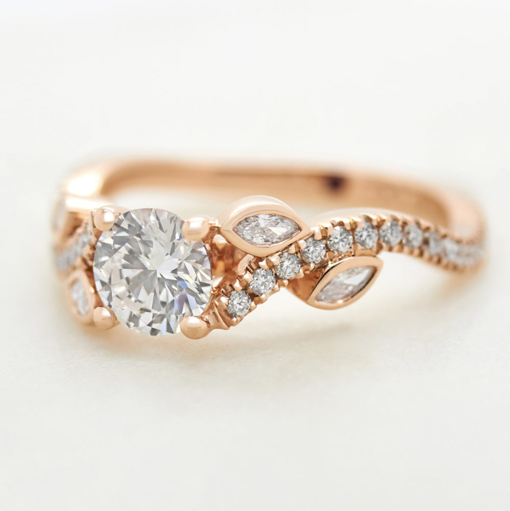 round diamond engagement ring with marquise and pave organic band rose gold