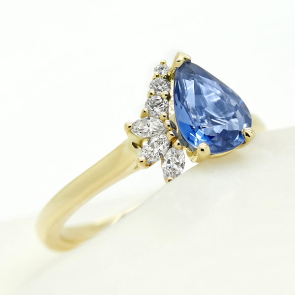 blue pear sapphire engagement ring with cluster marquise diamond half halo custom engagement ring yellow gold