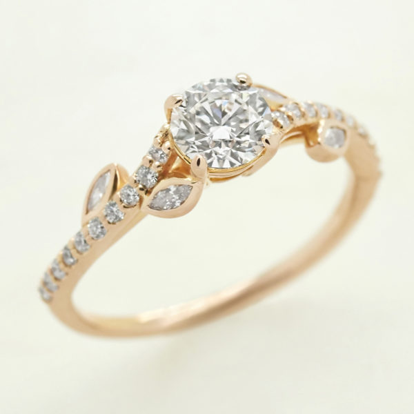 floral inspired round diamond engagement ring with marquise diamond accent stones