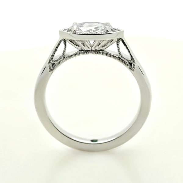 marquise east west diamond set custom engagement ring through the finger