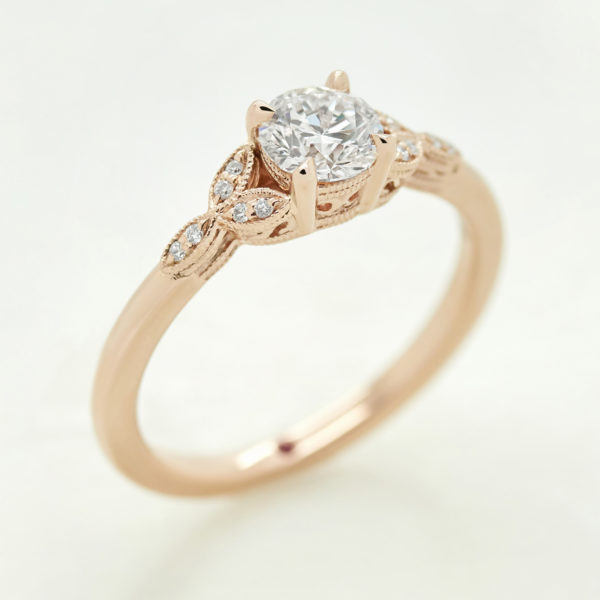 round diamond with marquise style sides rose gold
