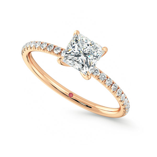 Rose gold engagement ring with a princess cut diamond and pave