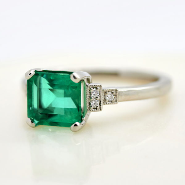 emerald cut emerald with side accent stones trilogy engagement ring