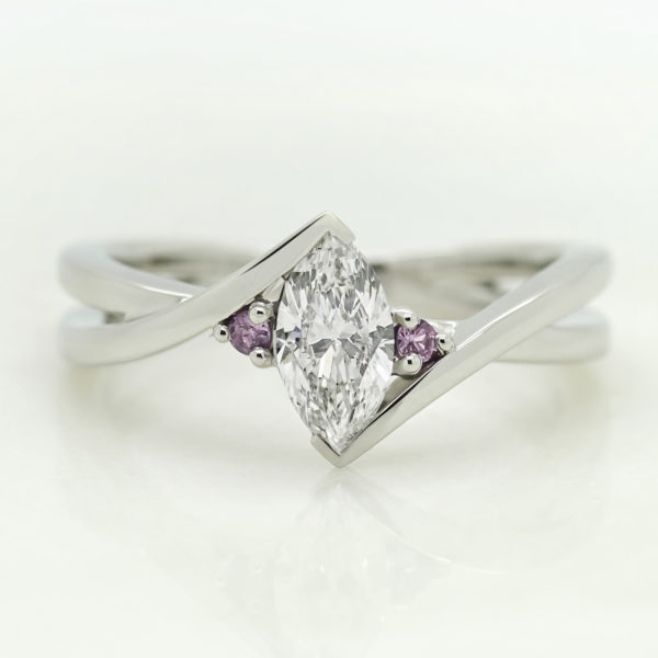 marquise diamond bypass setting trilogy engagement ring with pink sapphire accent stones
