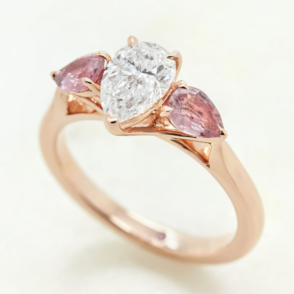 pear diamond rose gold trilogy engagement ring with pink pear sapphire accent stones